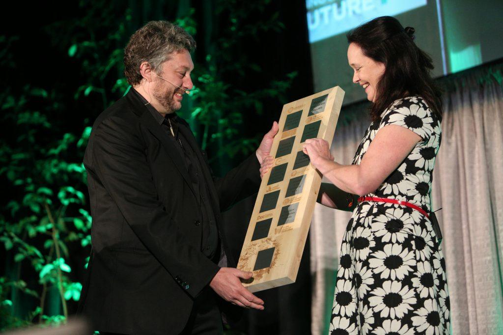 ILFI CEO Amanda Sturgeon presents former CEO Jason F. McLennan with an award at LF16. Photo by Danielle Barnum.