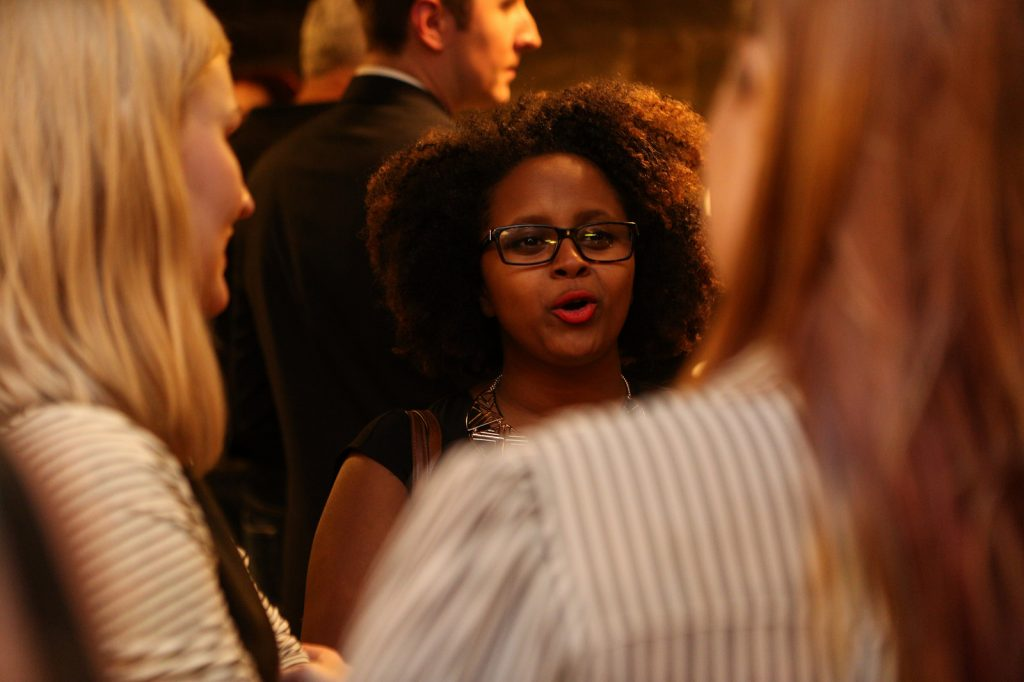 Attendees chat about truth and transparency. Photo by Danielle Barnum.