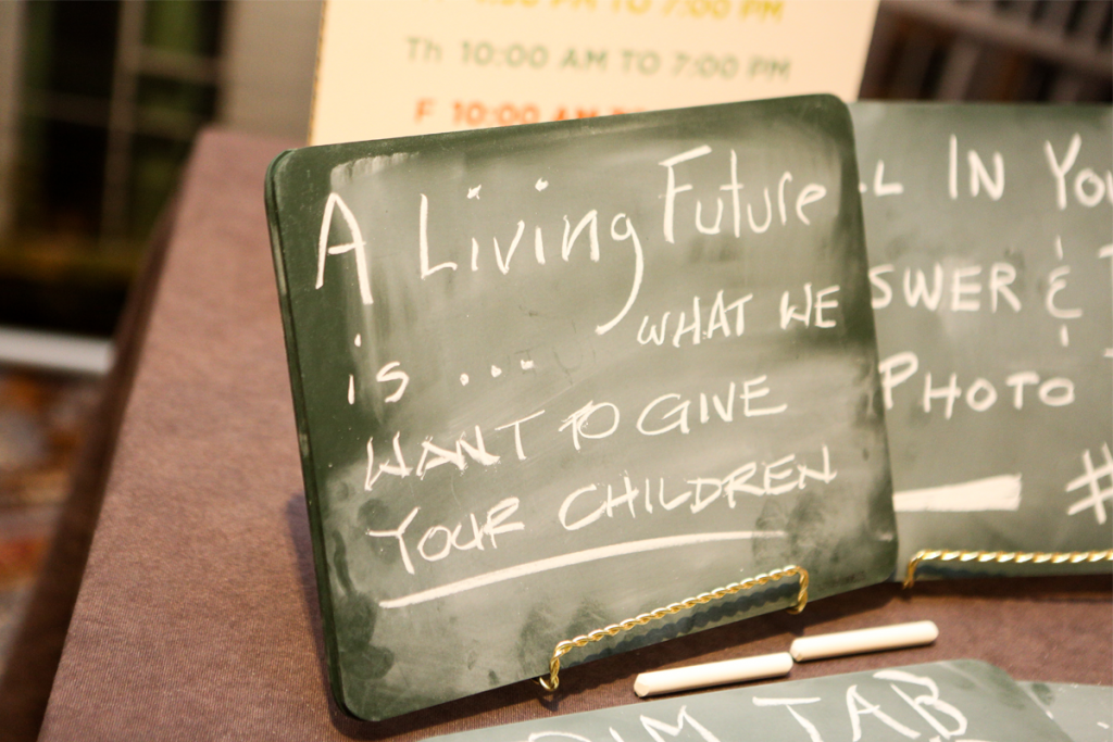 Chalkboards invited participants to write their vision of a Living Future. Photo by Danielle Barnum.